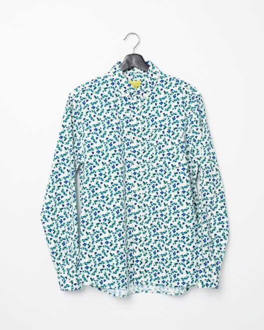 A product flat of a white and blue casual button down long sleeve shirt with an all over blueberry print