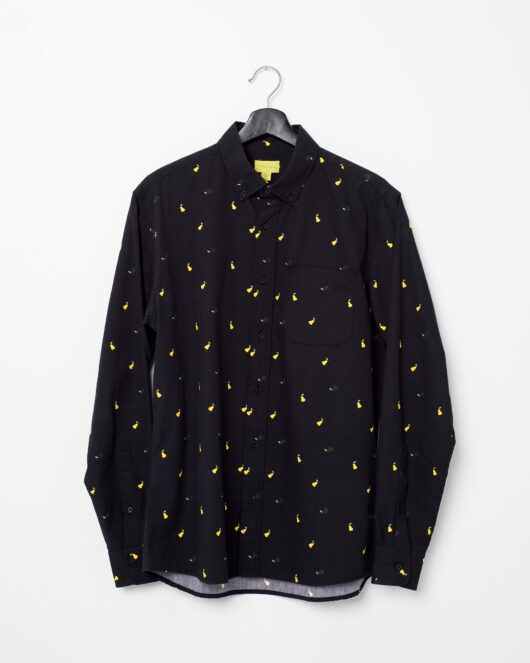 A product flat of a black casual button down long sleeve shirt covered with yellow pears