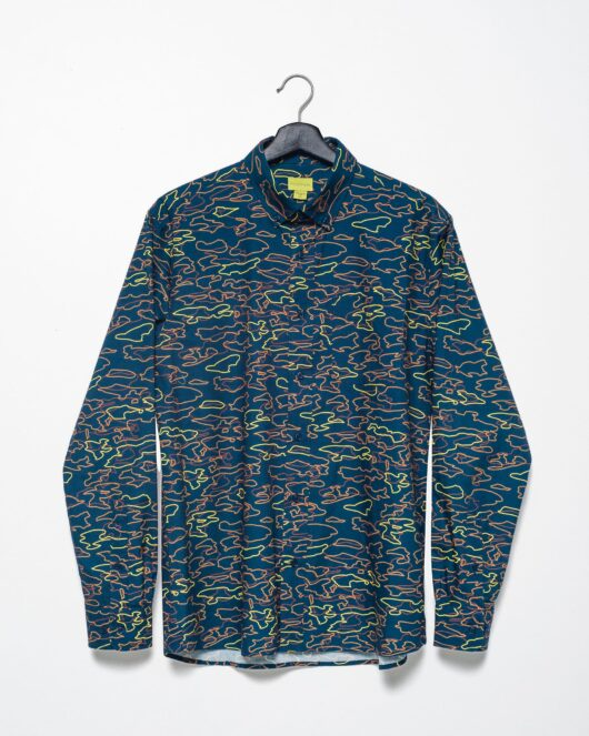 A product flat of a navy casual button down long sleeve shirt with an all over geometric camo print