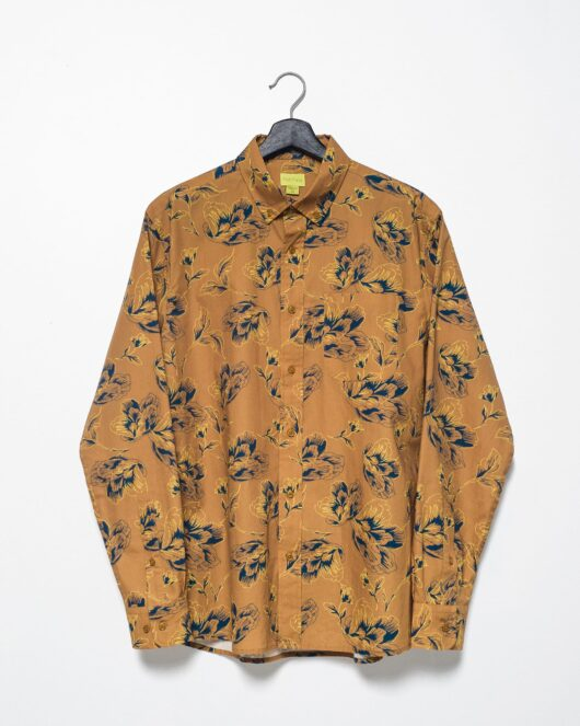 A product flat of a floral brown and navy casual button down long sleeve shirt with an all over large floral print