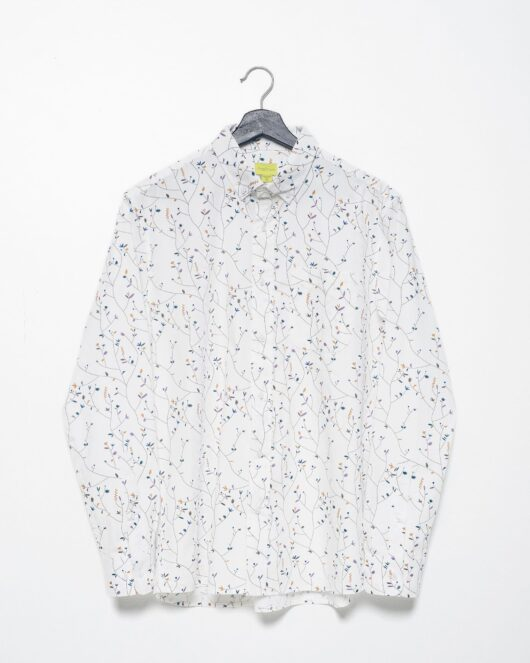 A product flat of a floral white casual button down long sleeve shirt with an all over floral vine print