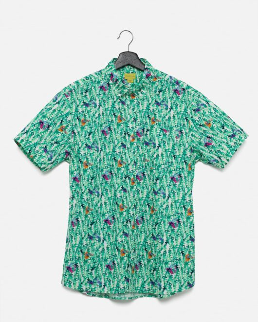 A product flat of a green colored casual button down short sleeve shirt with an allover seaweed and fish print
